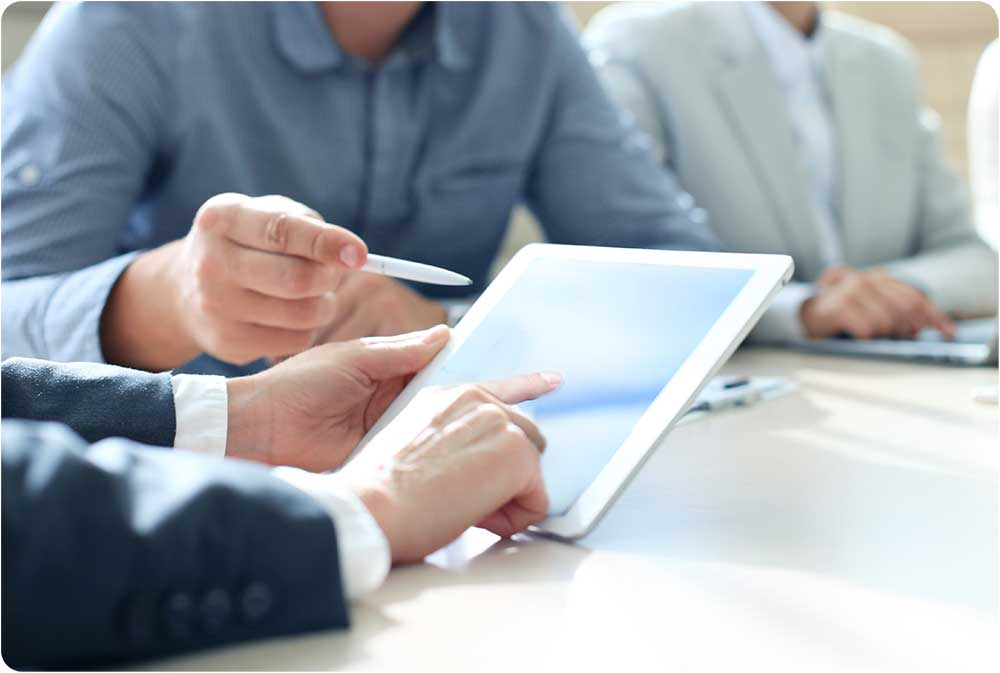 financial advisors reviewing e-application on tablet